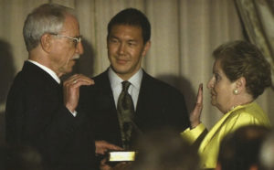 James Hormel is being sworn in by Secretary of State Madeline Albright, with his former partner Tim Wu holding a Bible.